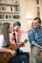 Happy family making music together at home - MOEF01084