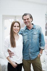 Portrait of happy couple embracing - MOEF01090