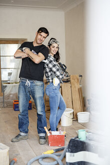 Happy couple renovating their new home - PESF01080