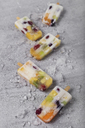 Homemade fruits and yogurt ice lollies on marble - RTBF01218