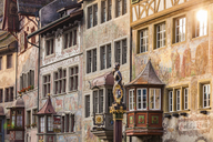 Switzerland, Stein am Rhein, Old town, historical houses at townhall square, fresco paintings, sculpture on fountain - WDF04614