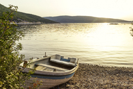 Greece, Pelion, Pagasetic Gulf, boat at the beach at sunset - MAMF00084