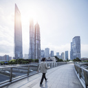 China, Shanghai, Skyline, man on footbridge - SPP00033