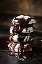 Stack of four meringue pastries with chocolate sauce - CSF29086
