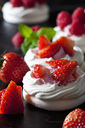 Meringue pastry garnished with whipped cream and strawberries - CSF29170