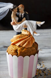 Carrot cup cake garnished with  cream topping, sugar granules and marzipan carrot - CSF29182
