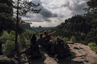 Germany, Saxony, Elbe Sandstone Mountains, friends on a hiking trip having a break - GUSF00731
