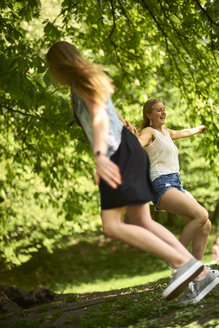 Two best friends dancing together in nature - BEF00004