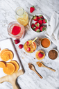 Strawberry and orange smoothie with curcuma and cinnamon on marble - RTBF01239