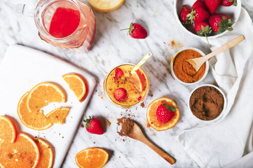 Strawberry and orange smoothie with curcuma and cinnamon on marble - RTBF01242