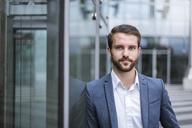 Portrait of confident young businessman - DIGF04093