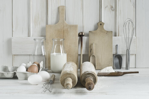Kitchen utensils, rolling pin, wire whisk, shovel, chopping board, eggs, flour and milk - ASF06180