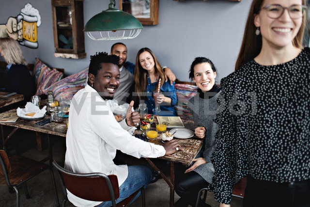 Cheerful multi-ethnic friends enjoying brunch at restaurant - MASF07541