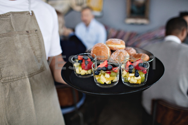 Midsection of owner holding food in serving tray at restaurant - MASF07571