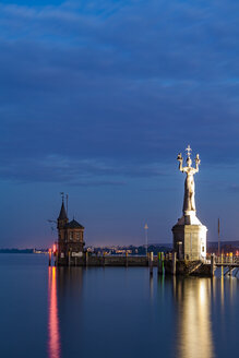 Germany, Constance, view to port entrance with lighthouse and Imperia at twilight - WDF04645