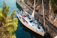 High angle portrait of man waving from yacht, Croatia - ISF00028
