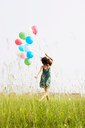 Woman with balloons running away - CUF00317