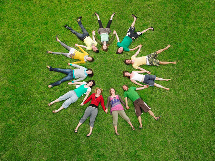 Crowd lying in grass in circle - CUF00668
