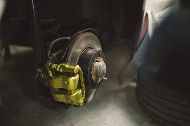 Detail of a disc and brake caliper of a car - RAEF02002