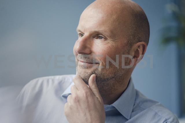 Portrait of smiling mature businessman looking sideways - KNSF03811