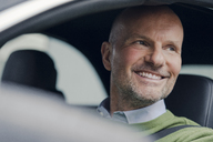 Portrait of smiling mature man in car - KNSF03814