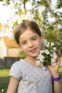 Portrait of smiling little girl with apple blossom - LVF06926