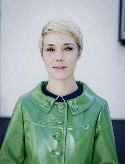 Portrait of woman wearing green vintage leather jacket - FLLF00027