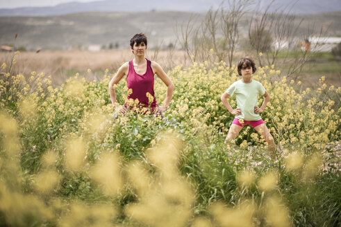 Mother and daughter doing yoga in nature - JSMF00174