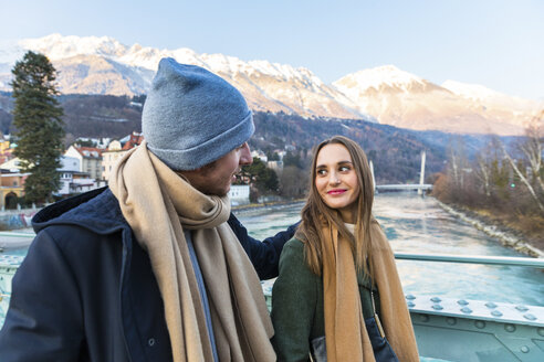 Austria, Innsbruck, young couple strolling together in winter - WPEF00224