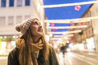 Content young woman on the street at Christmas time - WPEF00248