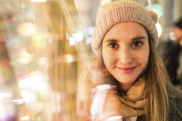 Portrait of smiling young woman at Christmas market - WPEF00251
