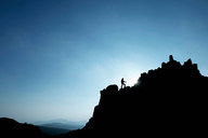 Man hiking on rocky hillside - CUF00723