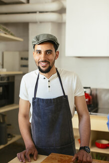 Portrait of smiling man in kitchen - EBSF02452