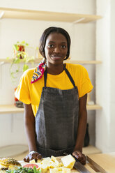 Portrait of smiling woman in kitchen - EBSF02455