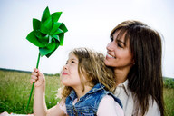Woman and girl with toy windmill - CUF00771