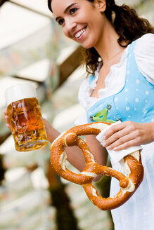 Young Woman with Glass Beer and Pretzel - CUF00804