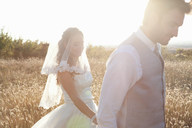 Newlywed couple walking outdoors - CUF00915