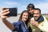 Happy family taking a selfie outdoors - DIGF04147