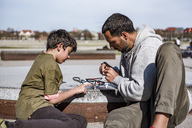 Father and son repairing drone - DIGF04174