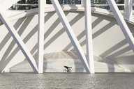 Spain, Valencia, City of Arts and Sciences, man on bicycle - FC01388