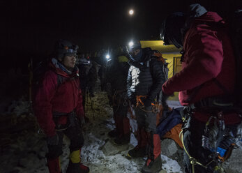 Nepal, Solo Khumbu, Mountaineers returning tp Everest Base Camp at night - ALRF01121