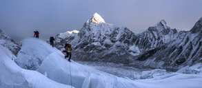 Nepal, Solo Khumbu, Mountaineers at Everest Icefall, Pumori in background - ALRF01127
