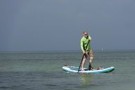 Thailand, Krabi, Lao Liang, man on SUP Board in the ocean - ALRF01163