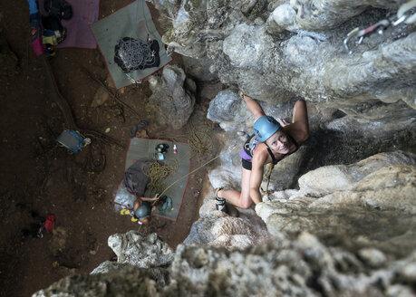 Thailand, Krabi, Railay Beach, woman climbing in rock wall - ALRF01169