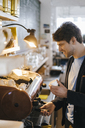 Man in a cafe preparing an espresso - KNSF03888