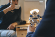Two men and robot on table - KNSF03900