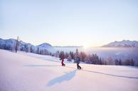 Austria, Tyrol, snowshoe hikers at sunrise - CVF00404