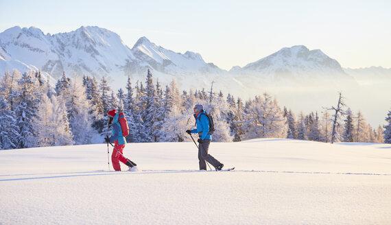 Austria, Tyrol, couple snowshoeing - CVF00407