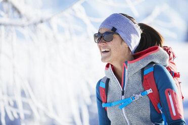 Austria, Tyrol, Portrait of smiling snowshoe hiker - CVF00422
