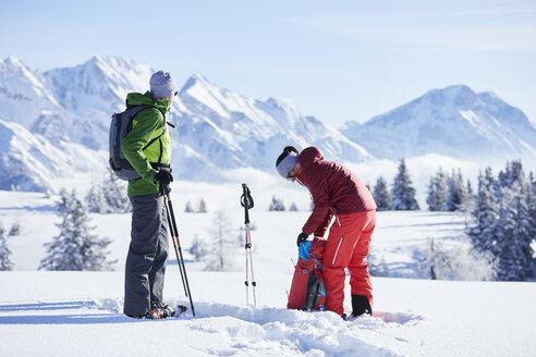 Austria, Tyrol, snowshoe hikers - CVF00425